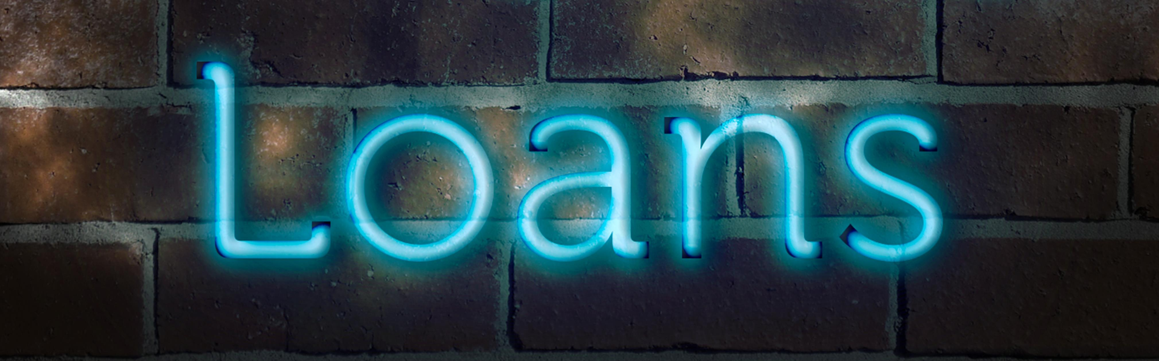 Blue Loan sign with black background